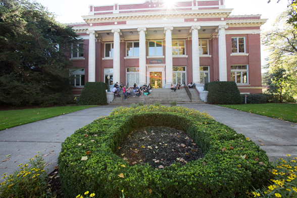 Students sitting on the steps of Johson Hall