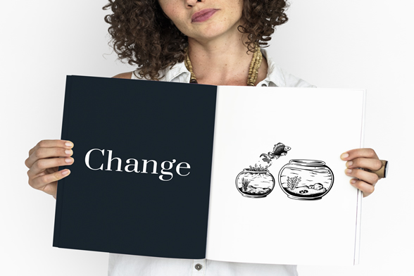 woman holding a sign that says change