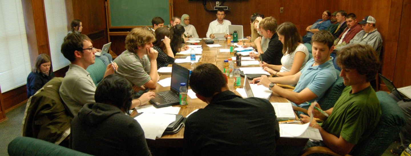 UO employees pictured around a conference table