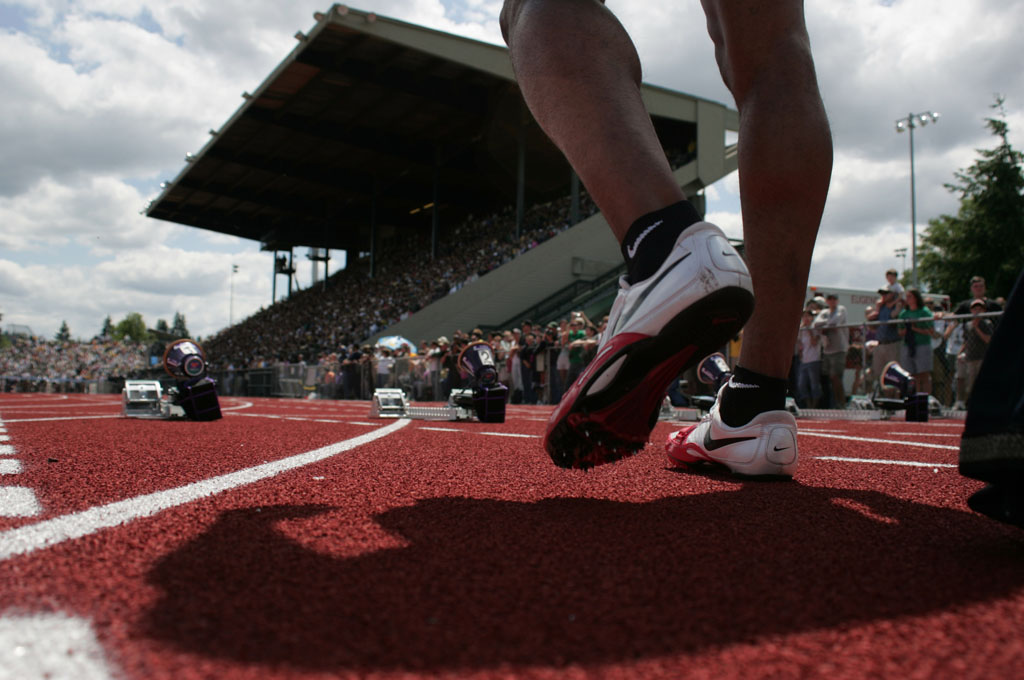 Picture of runner's legs with Hayward Field in the background