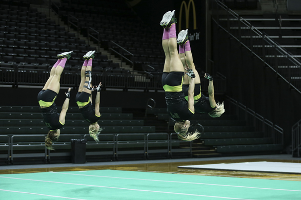 picture of gymnasts doing back flips